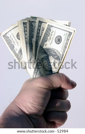american cash being held tight in the fist of a real humanbeing against a white background - stock photo