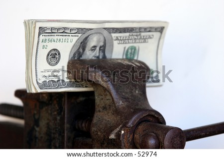 american cash held tightly in a vice with a white background - stock photo