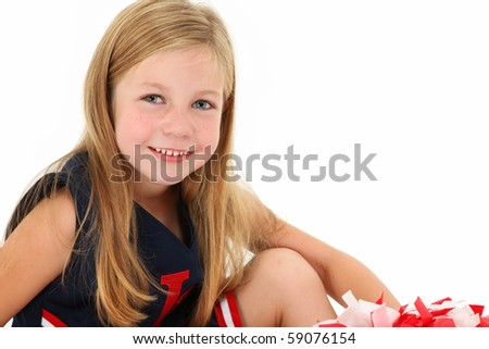 American child in cheer leader uniform over white.