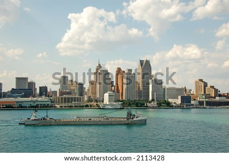 American city skyline with waterfront and barge - stock photo