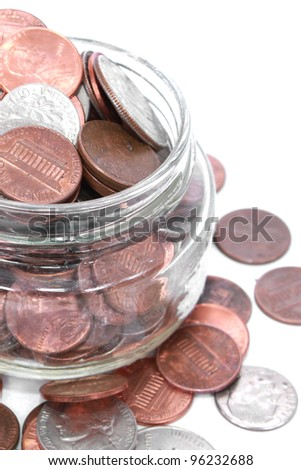 American coins in a glass jar - stock photo