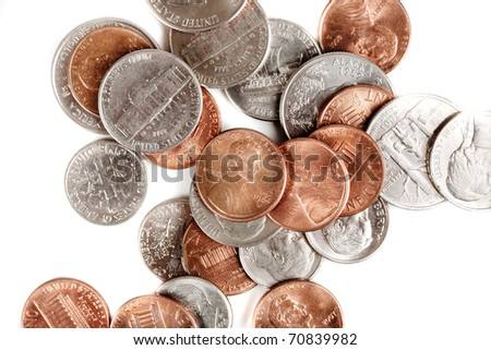 American coins laying flat on a white background. High Contrast. - stock photo