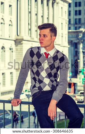 American College Student Studying in New York. Wearing black, white, gray patterned sweater, jeans, a young college student sitting on railing on campus, relaxing, thinking, Instagram filtered look. - stock photo