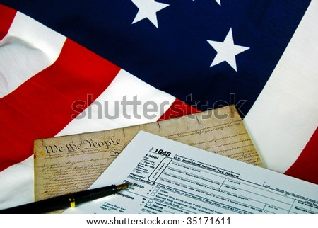 american constitution and tax form on flag