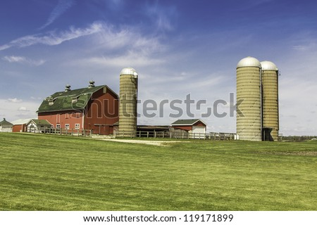 American country farm with silos against blue sky - stock photo