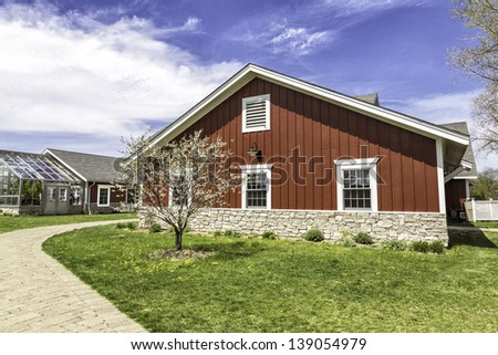 American countryside red farm with green house - stock photo
