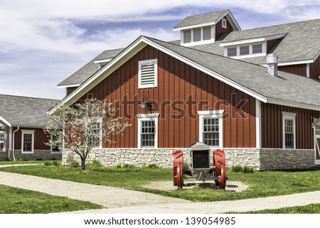 American countryside red farm with tractor - stock photo