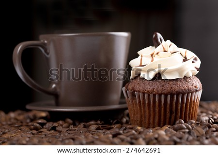 American cupcake and coffee, on black