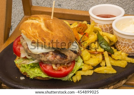American delicious and tasty burger with sauces and fries - stock photo
