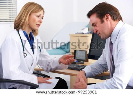 American doctor talking to depressed businessman - stock photo