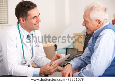 American doctor talking to senior man in surgery