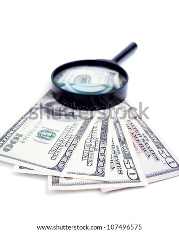 American Dollar-bills and magnifier glass isolated on white - stock photo