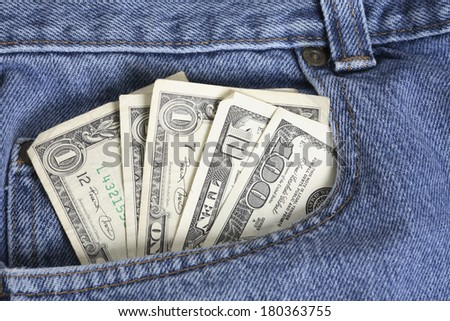 American dollar bills in jeans pocket  - stock photo