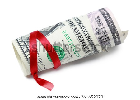American dollars and red ribbon on Holiday/Money - stock photo
