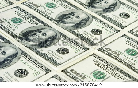 american dollars arranged at the background