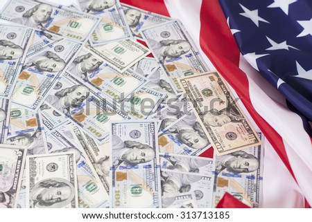 American dollars bills on flag background - stock photo