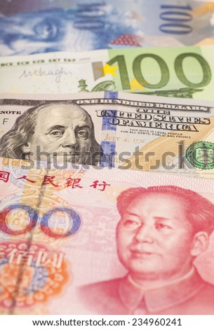 American dollars, European euro,Swiss franc and Chinese yuan bills - stock photo