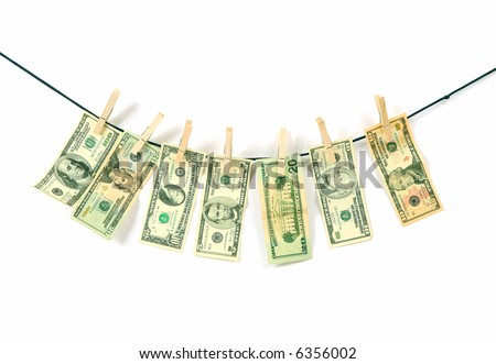 american dollars hung on a clothesline - stock photo