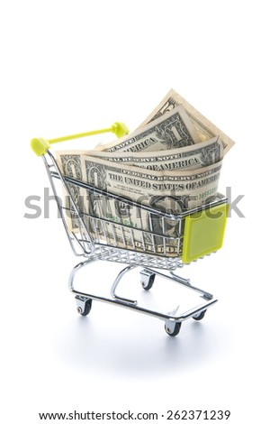 American dollars in a grocery cart.  - stock photo