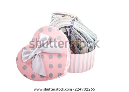 american dollars in a heart shaped gift box