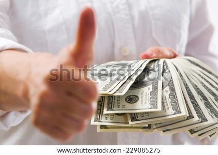 American dollars in a women hand. - stock photo