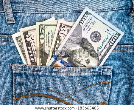american dollars in jean pocket - stock photo