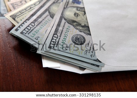 American Dollars in the Envelope on the Table closeup - stock photo