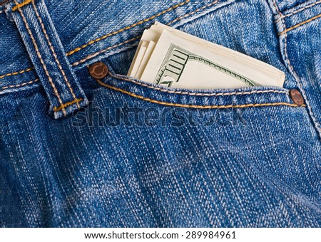 American Dollars in the pocket of blue jeans - stock photo