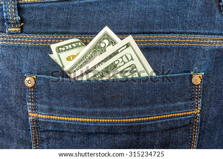 American Dollars in the Pocket of the Jeans closeup - stock photo