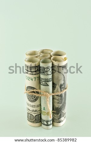American dollars tied with string.  Concept of Money is tied up - stock photo