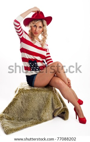 American-dressed girl in red hat gives a kiss - stock photo