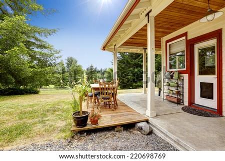 American farm house exterior. House with patio area. - stock photo