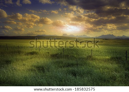 American farmland during sunset - stock photo