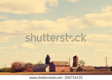 American Farmland With Blue Cloudy Sky - stock photo