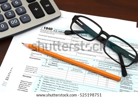 American federal tax form with glasses, calculator and pencil isolated on white. Fill out the us individual tax return form. Tax Day, Tax Preparation and Tax Payment Concept.