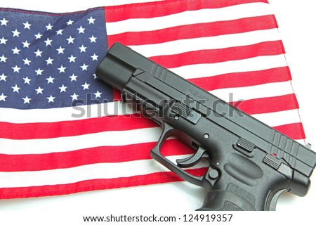 American Firearm/Autoloader handgun laying on US flag