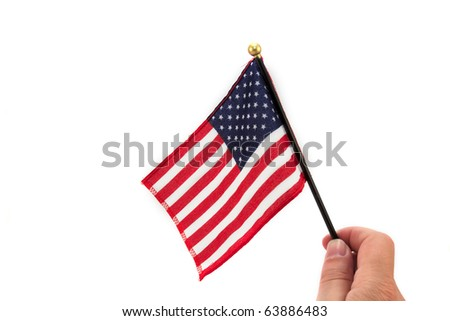 American Flag A human hand holding an American flag. Horizontal. - stock photo