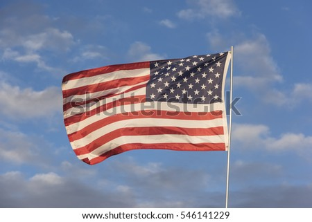 American Flag against a cloudy sky