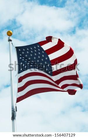 American flag against blue sky - stock photo