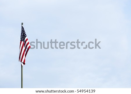 American flag against the blue sky - stock photo