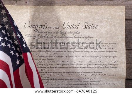 American flag and bill of rights on a wood background