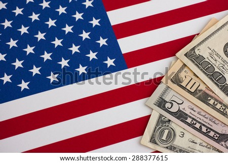 American flag and dollars. Close up.