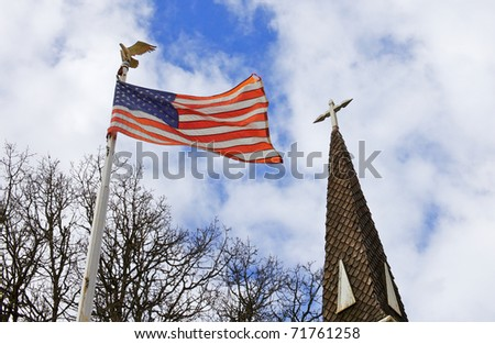 American flag and old church steeple reflect separation of church and state - stock photo