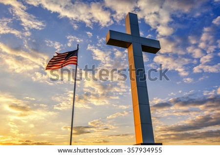 American flag and religious cross at sunset - stock photo