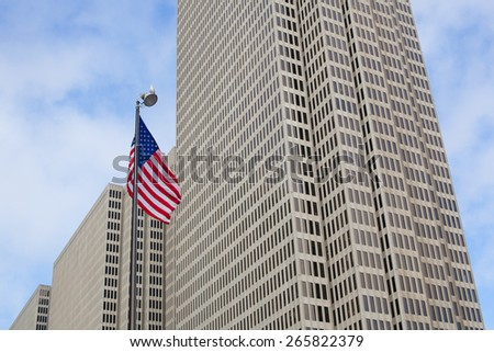 American Flag and Skyscraper in Downtown San Francisco - stock photo
