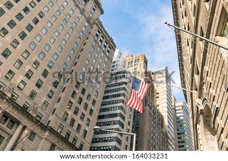 American Flag at Wall Street - New York financial District - stock photo