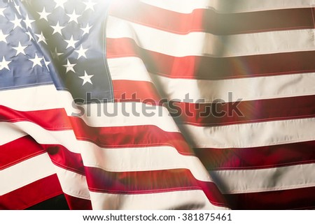 American flag background with sunlight - stock photo