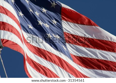 American Flag billowing in the wind. - stock photo