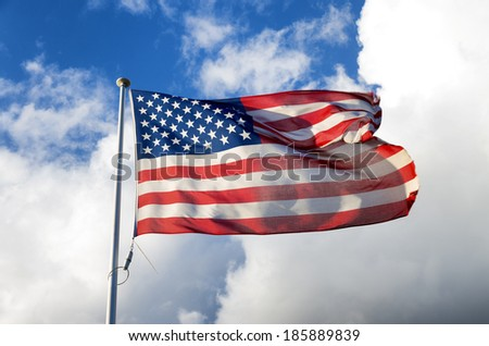 american flag blowing in the wind - stock photo