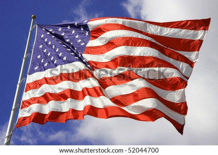 American Flag blows in the wind on the 4th of July. - stock photo